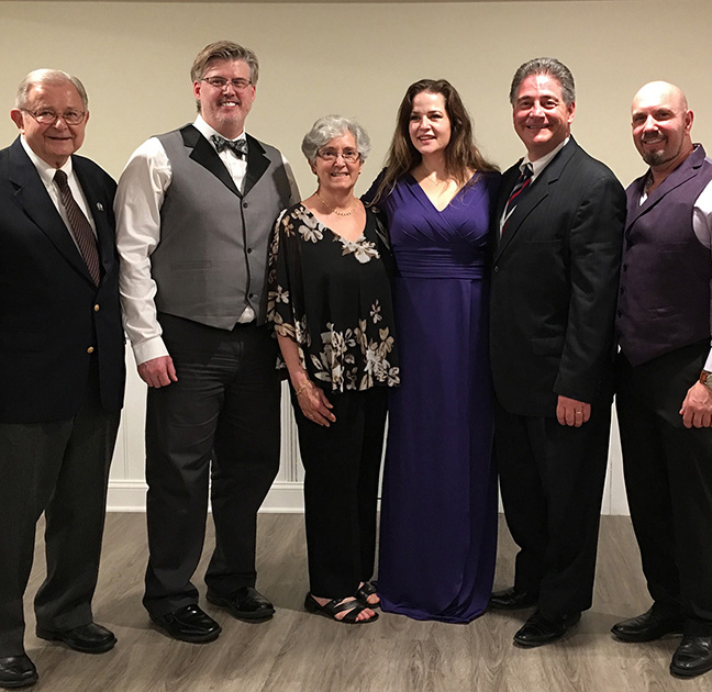 Photo of members of the Delaware Commission on Italian Heritage and Culture with performers at the 2018 UNICO Rehoboth Area's Annual Fundraiser