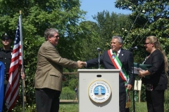Rehoboth Beach Mayor, Sam Cooper and Greve-in-Chianti Mayor, Alberto Bencista, shake hands to solidify their friendship and cooperation